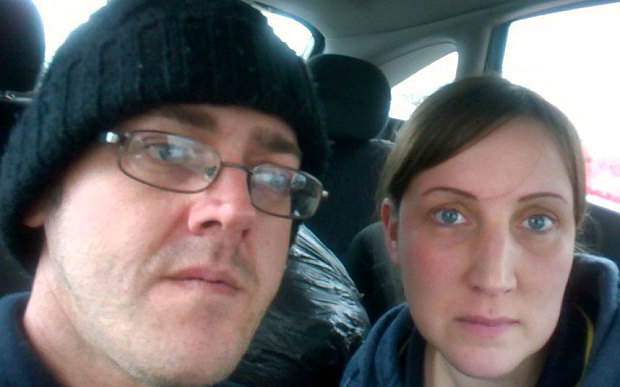 Philip and Victoria Sherlock pictured in their car becuase of payday loan debt